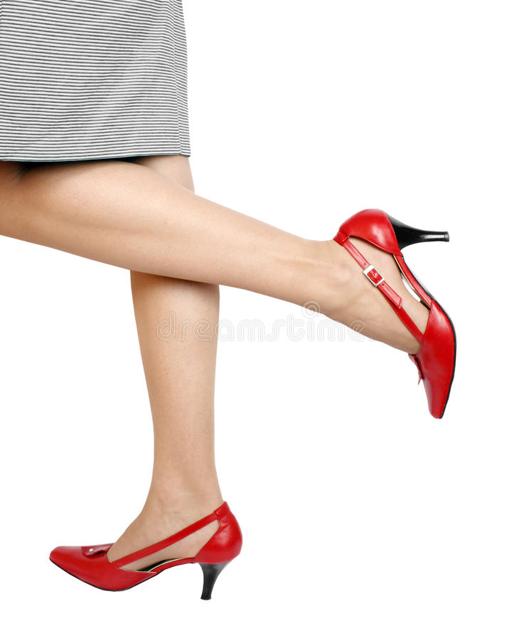 Beautiful legs. And red high heels shoes royalty free stock image