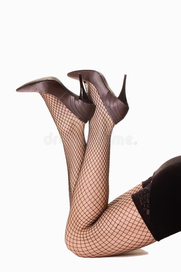Beautiful legs in foil-stockings and high heels s. Hoes, isolated royalty free stock image