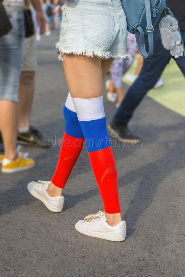 Beautiful legs of a girl in golf in the color of the flag royalty free stock images