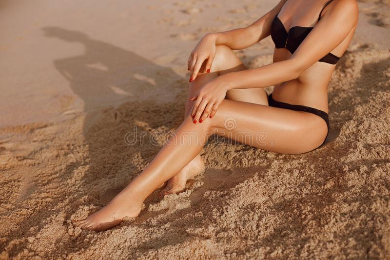 Beautiful Legs Outdoors By Beach Under Sunshine On Summer Day. Skincare. Protection Sun. Epilation Laser or Shaving Concept stock photos