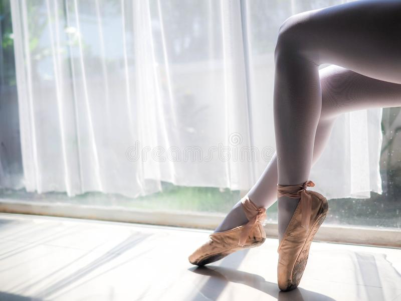 Beautiful legs of young ballerina. Ballet practice. Beautiful slim graceful feet of ballet dancer.  royalty free stock photo