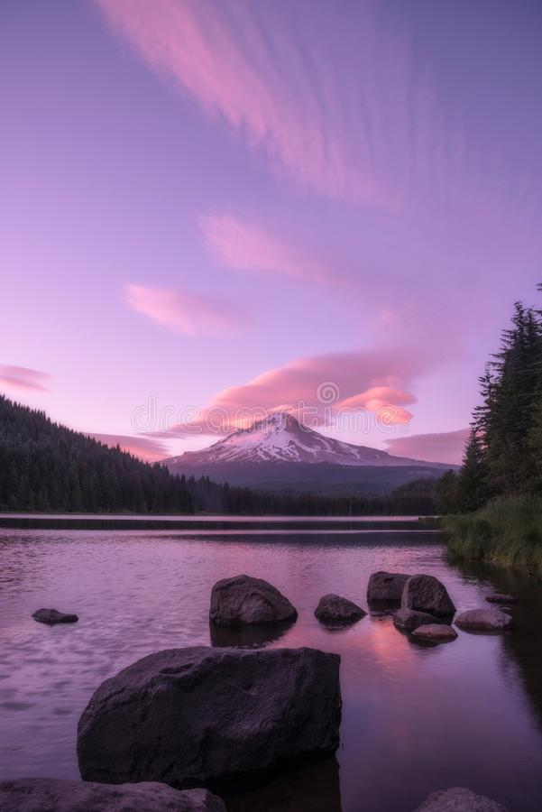 Beautiful lenticular clouds begin to form at sunset over Mt Hood and Trillium Lake, Oregon. Lenticular clouds begin to form over Mt Hood at sunset in Oregon over royalty free stock photos