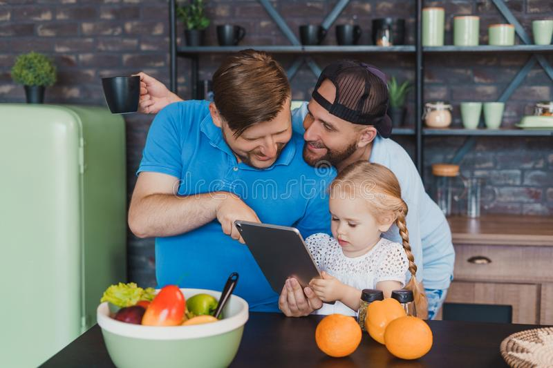 Beautiful LGBT family having a good time in the kitchen royalty free stock image