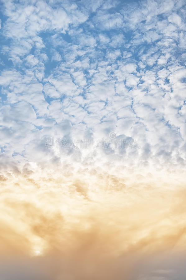Beautiful light clouds at sunset, textured background. The vertical frame royalty free stock photos