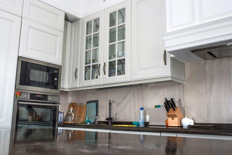 Beautiful light kitchen. New kitchen interior royalty free stock photo