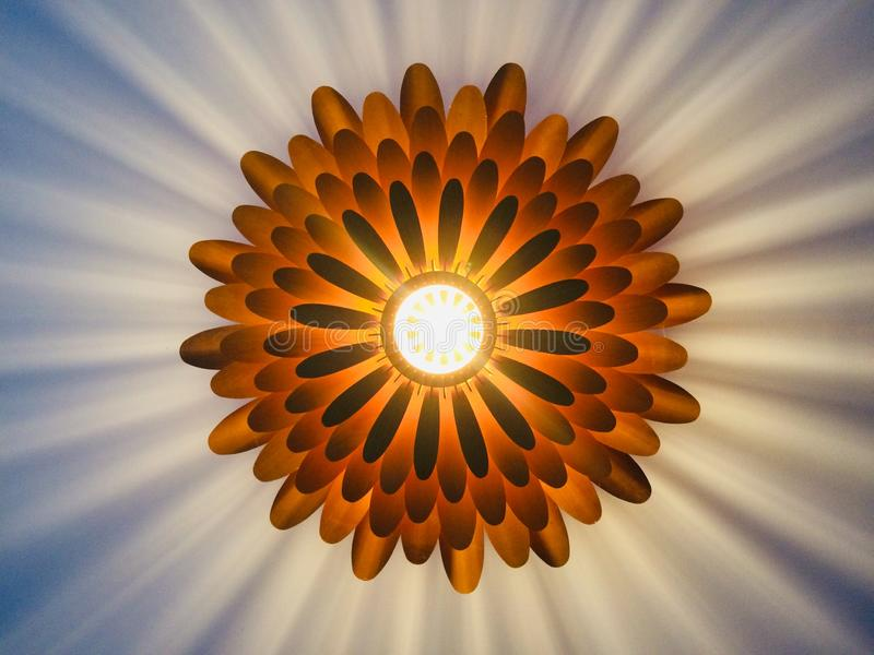 Blooming wooden light on the ceiling stock photo