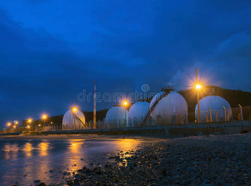 Beautiful lighting of gas lpg storage tank in petrochemical industry estate royalty free stock photos