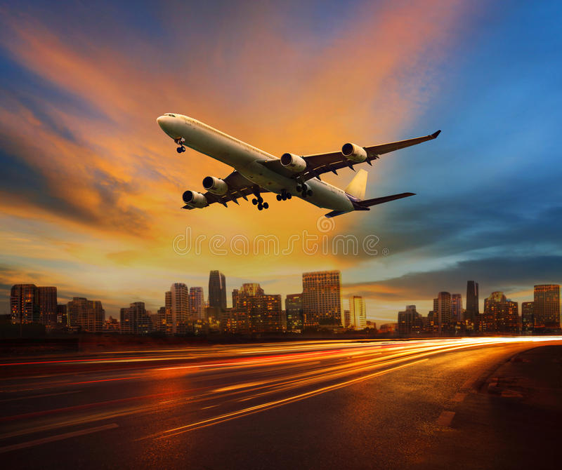 beautiful lighting of vehicle in land transportation and passenger jet plane flying above urban scene use for transport business royalty free stock photos