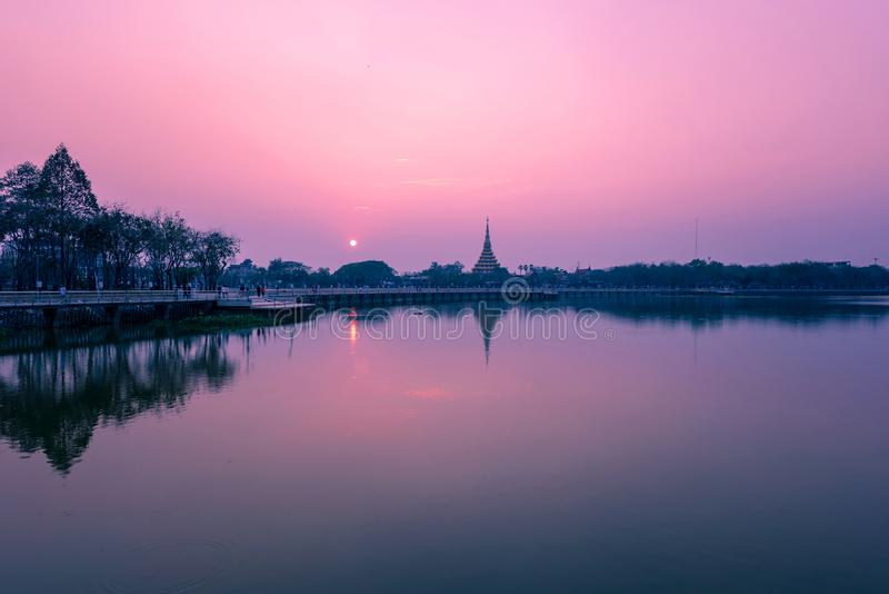 Beautiful lighting of Wat Nong Wang temple and reflection on the water at  Khonkaen province,Thailand. Beautiful lighting of Wat Nong Wang temple and reflection royalty free stock photos