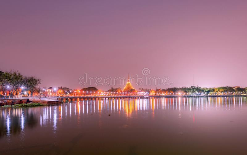 Beautiful lighting of Wat Nong Wang temple and reflection on the water at Khonkaen province,Thailand.  stock photos