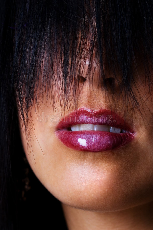 Beautiful lips with shiny lipstick. On a young female stock photography