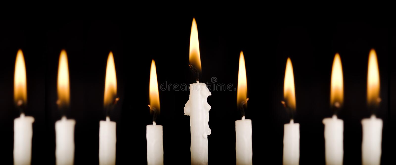 Beautiful Lit Hanukkah Candles On Black. Royalty Free Stock Photo