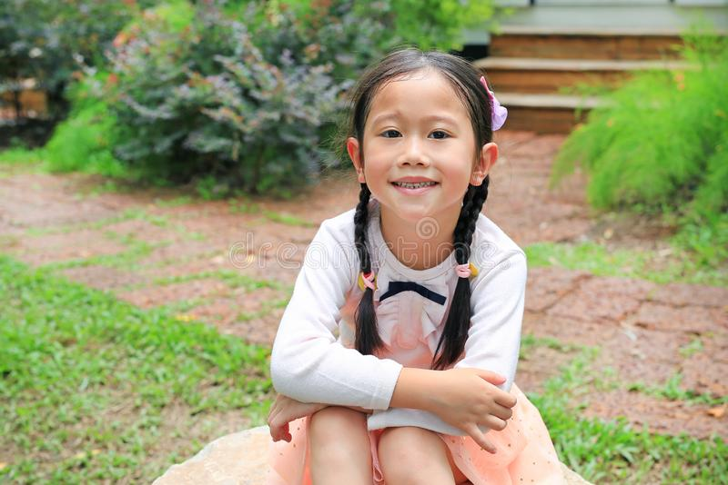 Beautiful little Asian child girl in the nature garden royalty free stock image