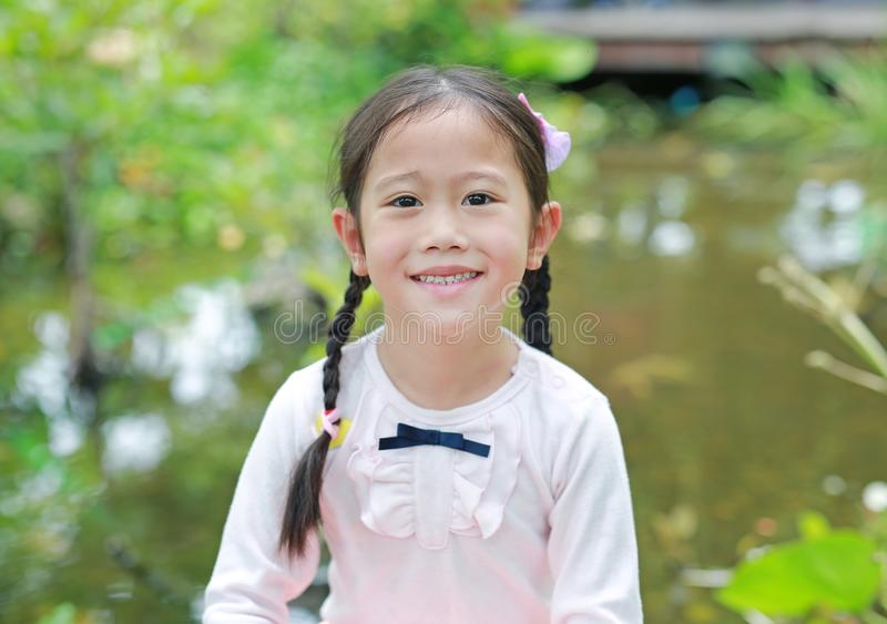 Beautiful little Asian child girl in the nature garden royalty free stock photos