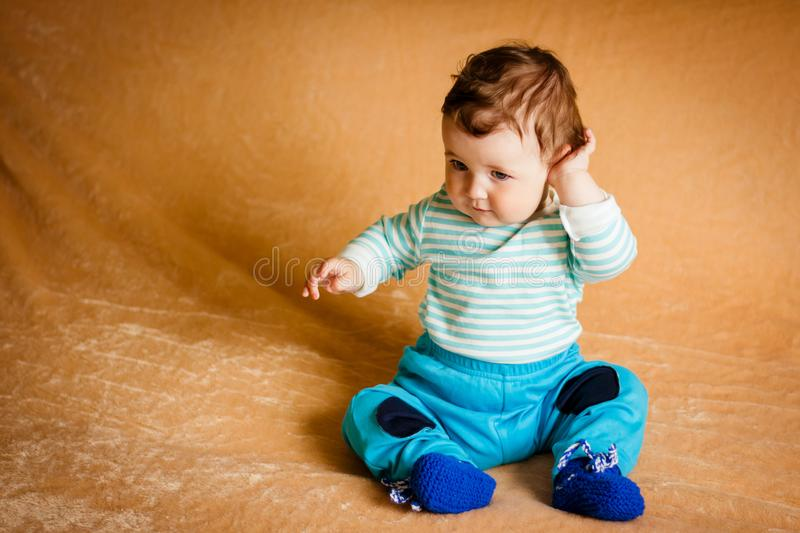 A beautiful little baby with blue eyes royalty free stock photos