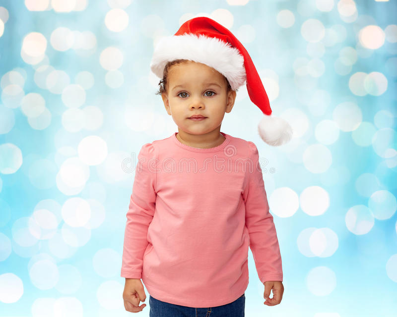 Beautiful little baby girl in christmas santa hat royalty free stock photography