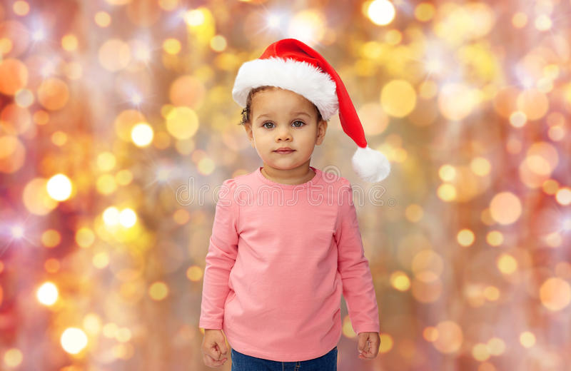 Beautiful little baby girl in christmas santa hat stock photos