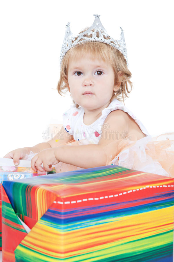Beautiful little baby girl with gift box royalty free stock photo