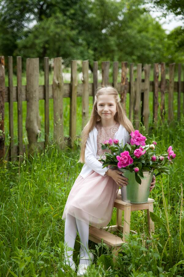 Free Beautiful Little Blonde Girl With Metal Bucket With Peonies Royalty Free Stock Image - 177617126