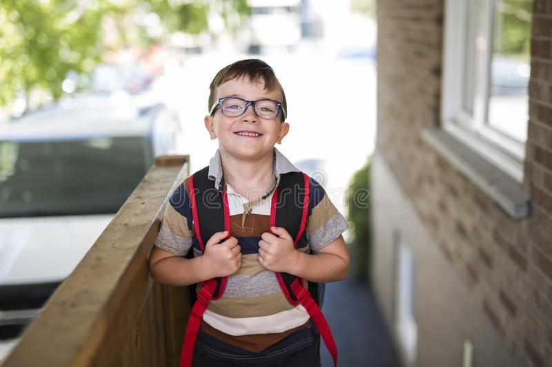 Beautiful little boy with backpack ready back to school royalty free stock images