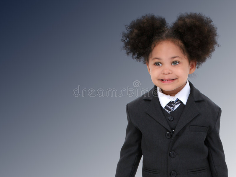Beautiful Little Business Woman in Suit and Tie Over Dark Blue stock images
