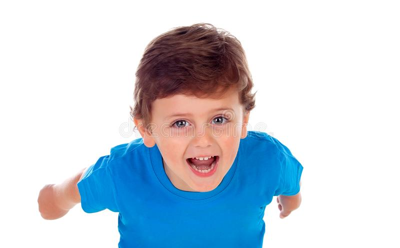 Beautiful little child three years old wearing blue t-shirt runing royalty free stock photo