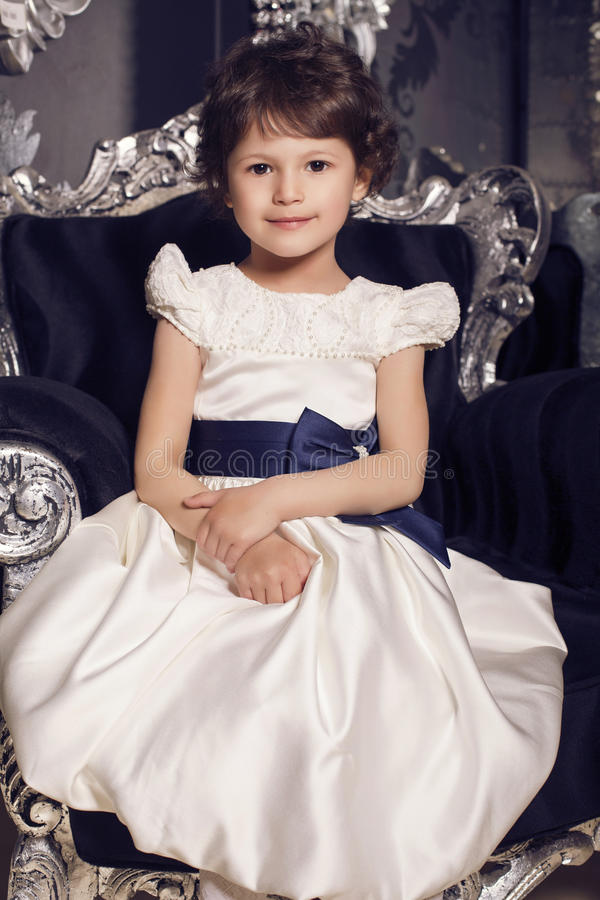 Beautiful little cute girl in elegant dress royalty free stock photo