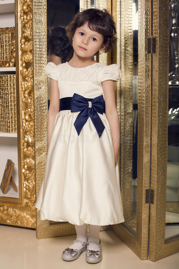 Beautiful little cute girl in elegant dress royalty free stock photography
