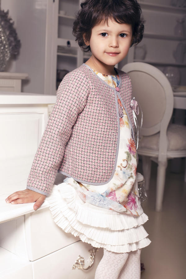 Beautiful little cute girl in elegant dress royalty free stock photos