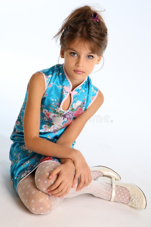 Beautiful Little Girl In An Asian Blue Dress In Fashion Style Stock Image - Image Of -9692