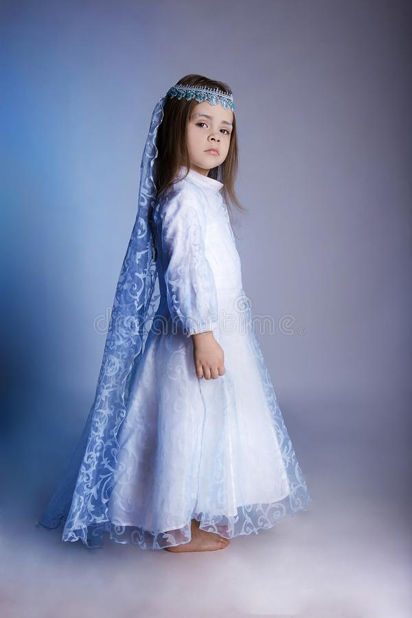 Winter queen style child. costume. Beautiful little girl beauty portrait. winter queen style child costume royalty free stock photography