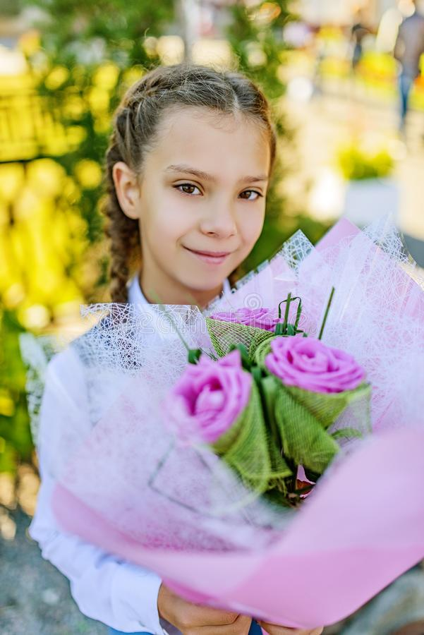 Beautiful little girl with big bouquet of flowers royalty free stock photos