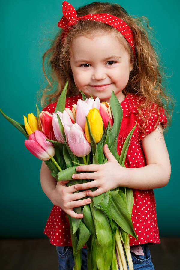 Download Beautiful Little Girl With A Big Bouquet Of Tulips. Stock Photo - Image of green, brown: 51142934