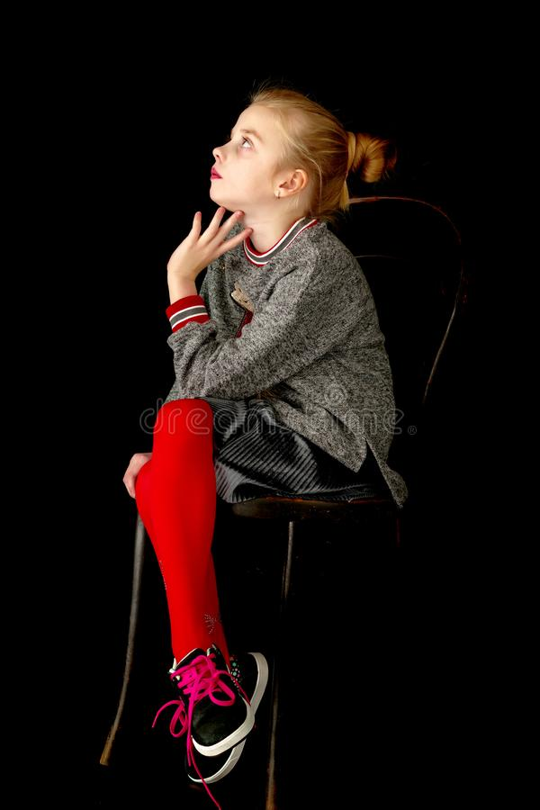 Little girl on a black background royalty free stock photos