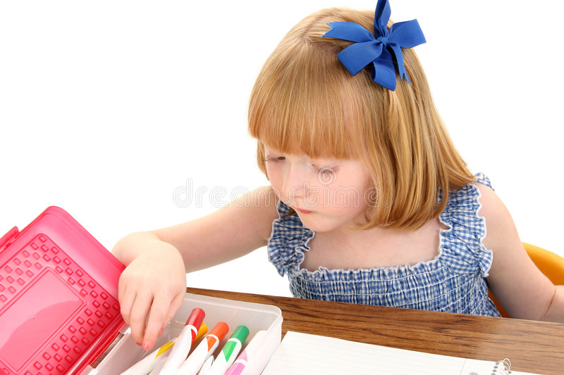 Beautiful Little Girl With Box of Markers on White Background stock photo