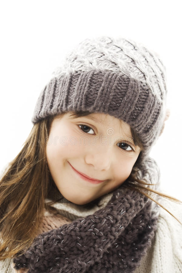 Beautiful little girl in cap and scarf. royalty free stock image