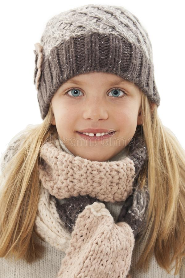 Beautiful little girl in cap and scarf. Winter style royalty free stock photos