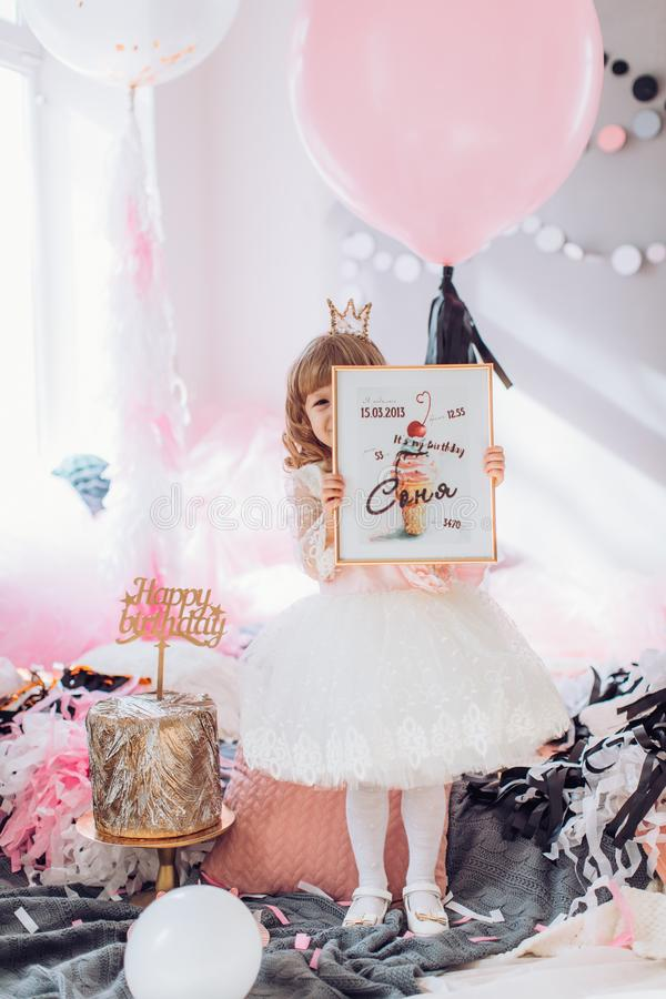Beautiful little girl celebrating birthday party royalty free stock image