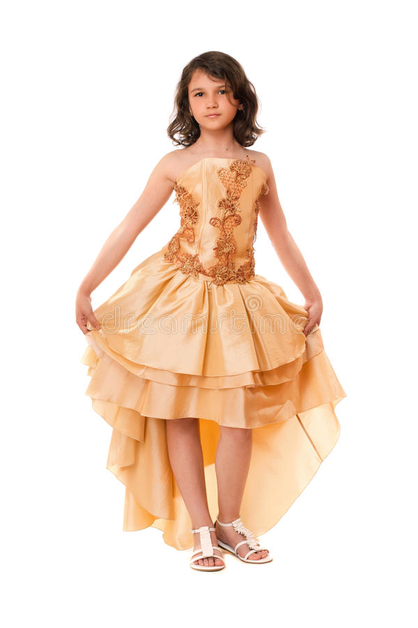 Beautiful little girl in a chic dress stock photo