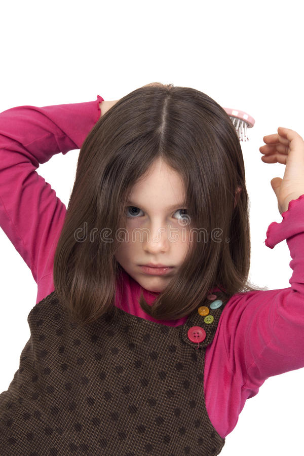 Beautiful Little Girl Combing Royalty Free Stock Image