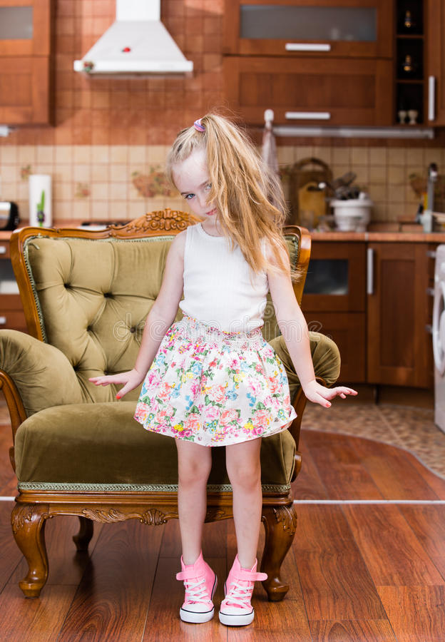 Beautiful little girl dancing in middle of room stock images