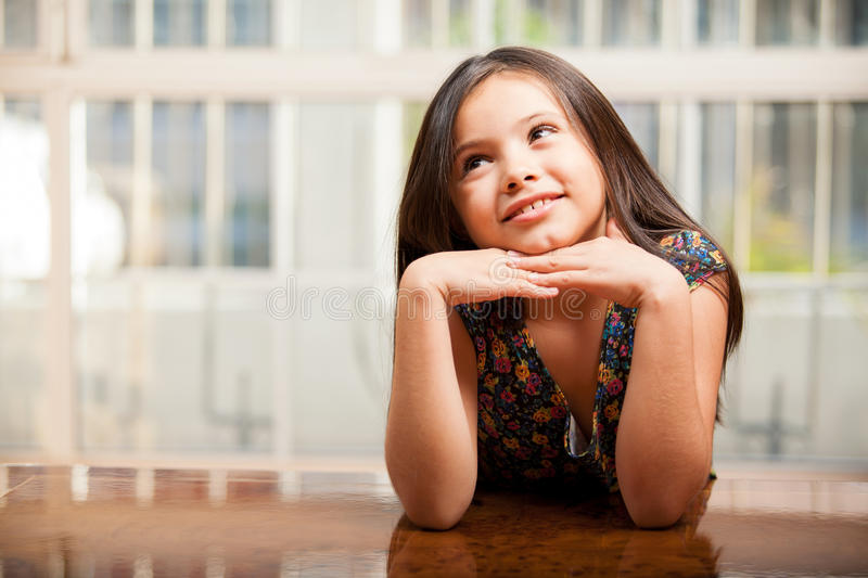Download Beautiful Little Girl Daydreaming Stock Photo - Image: 34082910