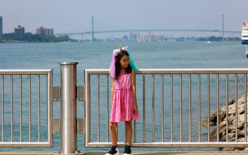 Beautiful little girl at Detroit Michigan, high definition picture of the Ambassador bridge between USA and Canada royalty free stock image