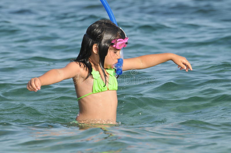 Beautiful little girl with the diving equipment royalty free stock images