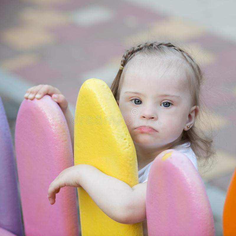 Beautiful little girl with Down syndrome stock photo