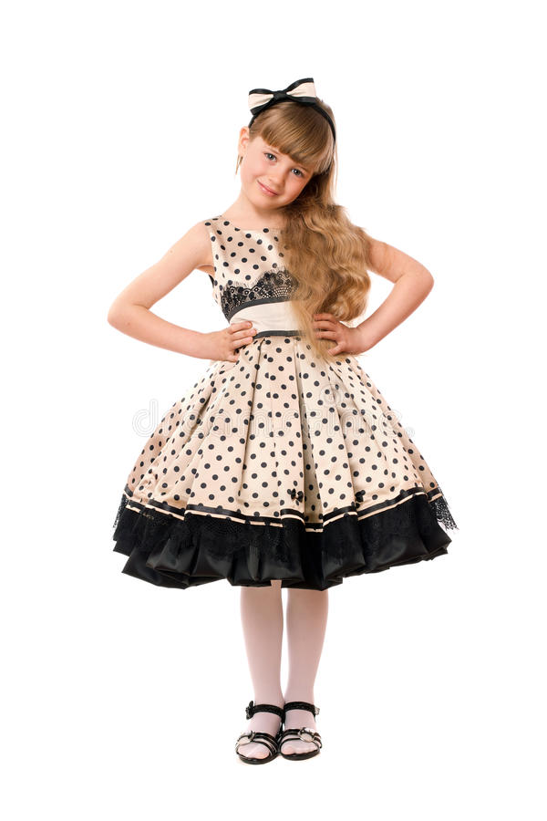 Beautiful little girl in a dress stock images