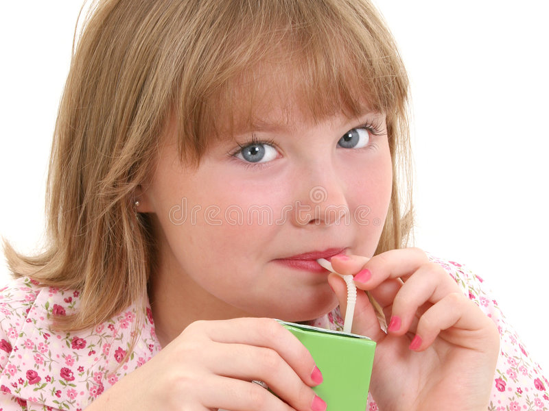 Beautiful Little Girl Drinking From Juice Box royalty free stock photography