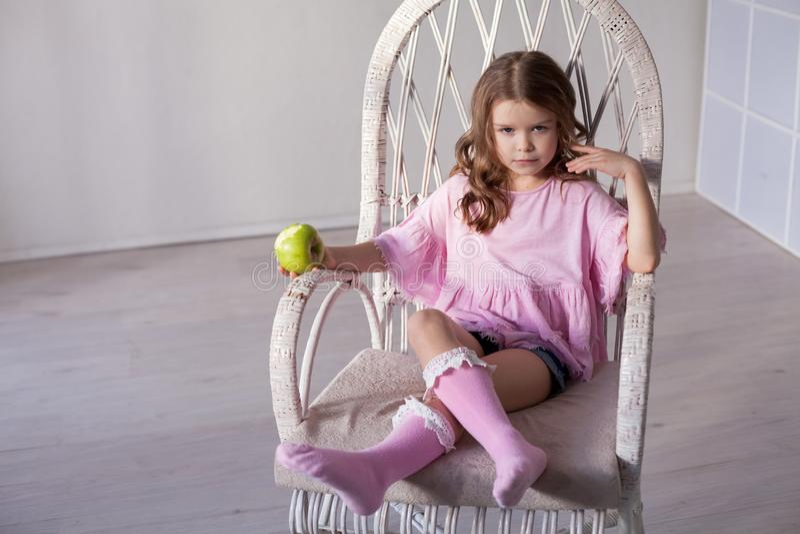 Beautiful little girl drinking milkshake through a straw stock image