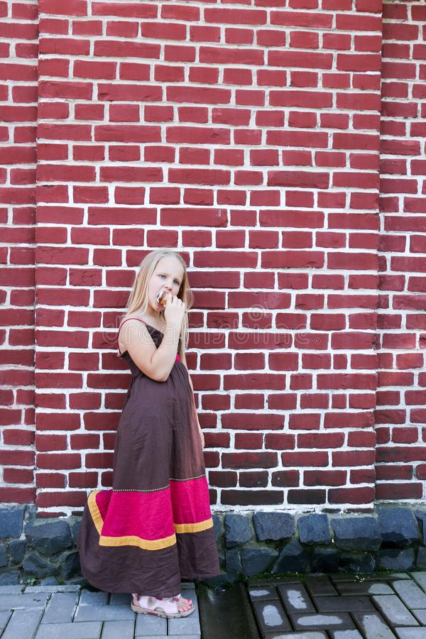 Beautiful little girl eats ice-cream in the summer royalty free stock photography