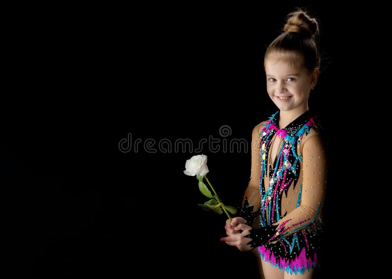Little girl with a flower in her hand. royalty free stock image